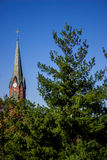 Historic Church Steeple and Trees. Historic building near the state capital of Missouri. Classic architecture of a red brick church steeple sticking up above the Stock Image
