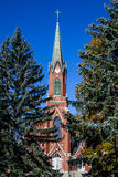 Historic Church Steeple and Trees. Historic building near the state capital of Missouri. Classic architecture of a red brick church steeple sticking up above the Royalty Free Stock Photo
