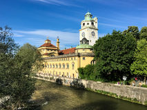 Historic church with tower on riverbank Royalty Free Stock Photo
