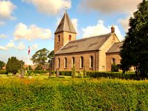 The historic church in Vesterrmarie. Surrounded by a cemetery Gothic church in Vesterrmarie on the Danish island of Bornholm Royalty Free Stock Photography
