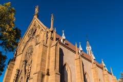 Historic church in warm evening light under a vivid blue sky in Santa Fe, New Mexico royalty free stock photo
