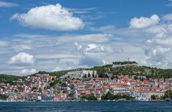 Historic city of Åibenik - panoramic view from sea. Panoramic view of historic, medieval, mediterranean city of Åibenik with its crowded stone built houses royalty free stock image