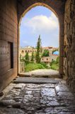 Historic city of Byblos, Lebanon. The historic city of  Byblos in Lebanon viewed from the gate entrance of the crusaders' castle. A view of the mosque and the Royalty Free Stock Images