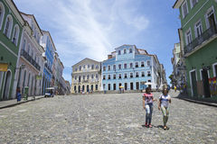 Historic City Center of Pelourinho Salvador Brazil. SALVADOR, BRAZIL - MARCH 12, 2015: Pedestrians walk through a plaza surrounded by colonial buildings in the Royalty Free Stock Photo