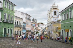 Historic City Center of Pelourinho Salvador Brazil. SALVADOR, BRAZIL - MARCH 12, 2015: Tourists gather in a plaza surrounded by colonial buildings in the Stock Image