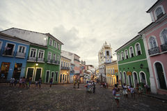 Historic City Center of Pelourinho Salvador Brazil. SALVADOR, BRAZIL - OCTOBER 12, 2013: Tourists and locals mix in a plaza as dusk falls over the historic city Royalty Free Stock Images