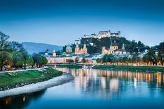 Historic city of Salzburg with Festung Hohensalzburg at dusk Stock Image