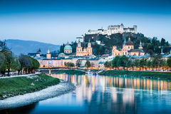 Historic city of Salzburg with Festung Hohensalzburg at dusk. Beautiful view of Salzburg skyline with Festung Hohensalzburg and Salzach river at blue hour Stock Photo