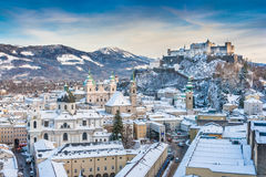 Historic city of Salzburg with Festung Hohensalzburg in winter. Beautiful view of the historic city of Salzburg with Festung Hohensalzburg in winter, Salzburger Stock Images