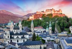 Historic city of Salzburg with Hohensalzburg Fortress at dusk, S Stock Images