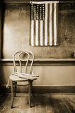 Historic classroom with 38 star flag and paddles f royalty free stock photography