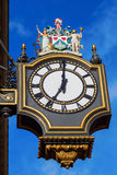 Historic clock at a building in London, UK Royalty Free Stock Photo