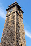 Historic clock tower against blue Stock Images