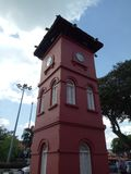 Historic Clock Tower in Melaka. The Stadthuys an old Dutch spelling, meaning city hall, also known as the Red Square, is a historical structure situated in the Royalty Free Stock Photos