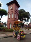 Historic Clock Tower in Melaka. The Stadthuys an old Dutch spelling, meaning city hall, also known as the Red Square, is a historical structure situated in the Stock Image