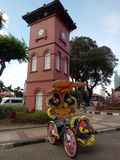 Historic Clock Tower in Melaka. The Stadthuys an old Dutch spelling, meaning city hall, also known as the Red Square, is a historical structure situated in the Stock Images