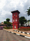 Historic Clock Tower in Melaka. The Stadthuys an old Dutch spelling, meaning city hall, also known as the Red Square, is a historical structure situated in the Royalty Free Stock Image