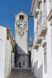 Historic clock tower view - Church of Santa Maria do Castelo- in the city Tavira, Algarve, Portugal Royalty Free Stock Photography