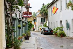 Historic cobblestone Street lined with shops. Royalty Free Stock Image