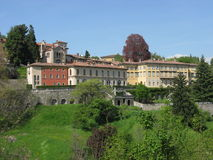 Historic colored buildings and park, BERGAMO, ITALY. Historic colored buildings and park with clear blue sky in warm and sunny spring day: BERGAMO, LOMBARDY Royalty Free Stock Photo