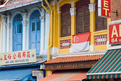 Historic, Colorful Textile Shops. KAMPONG GLAM, SINGAPORE - AUGUST 17, 2016: Colorful textile shops in historic buildings line North Bridge Road in the Malay Royalty Free Stock Photography