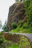 Shepperds Dell. The Historic Columbia River Highway near Shepperds Dell in Multnomah County, Oregon, caved into the steep cliffs of the Columbia River Gorge Royalty Free Stock Images