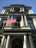 Historic Column Building With US Flag Stock Images