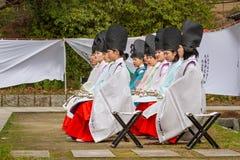 Historic Coming-of-Age Event Women Sitting. KOKURA, KITAKYUSHU, JAPAN - FEBRUARY 26, 2017: Young women having participated in a historic coming-of-age ceremony royalty free stock photos