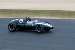 Historic Cooper F1 racing car at speed. Festival of Motorsport: 1959 Cooper Formula 1 race car competing in a Historics Revival Series Royalty Free Stock Image
