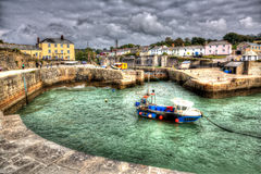 Historic Cornish harbour Charlestown near St Austell Cornwall England UK with clear blue sea in HDR Royalty Free Stock Photography