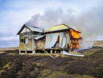 Historic cottage in paddock burning down. Stock Image