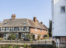 Historic cottages in Tewkesbury, Gloucestershire, UK. Pretty timbered and brick cottages behind Abbey Mill on the banks of the River Avon in summer, Tewkesbury Stock Photo