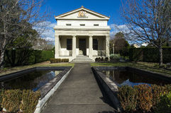 Historic Court House Berry. The historic court house Berry New South Wales with reflections in the pond at the front. Copyspace stock photography