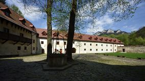 Red Monastery Museum, Spis region, Slovakia. Historic court with old well in Red monastery museum - Spis region - Slovakia stock photo