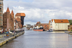 Historic crane and National Maritime Museum in Gdansk, Poland Royalty Free Stock Images