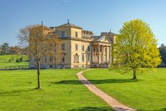 Historic Croome Court on a sunny Spring day. Historic Croome Court, a Neo-Palladian designed house on a sunny spring day. `Capability` Brown originally stock photo