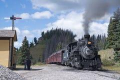 Historic Cumbres Toltec narrow-gauge train steam engine enroute to Antonito, Colorado train station royalty free stock photo