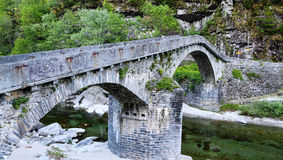 Historic curved stone bridge Stock Photo