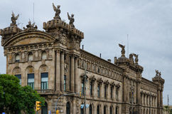 Historic custom house building with statues in Barcelona, Spain Stock Photos