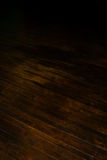 Historic dark brown hardwood floor. Aged dark brown hardwood floor over 100 years old with shadow area for copy text Royalty Free Stock Photos