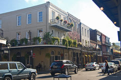 Historic Decator Street  buildings in New Orleans French Quarter. Historic New Orleans  building with wrought-iron balconies on Decator Street in the French Royalty Free Stock Photography