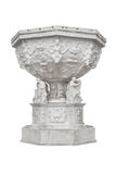 The historic, decorated baptismal font - isolated on white Stock Images