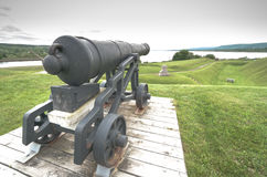 Historic defence, cannons, now relics of the past, sit on their mounts. Stock Image