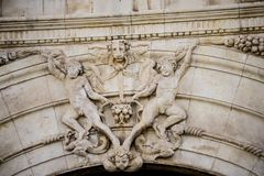 Historic details of stone sculptures of the facade of the Univer. Sity of Alcalá de Henares. Madrid, Spain Royalty Free Stock Images