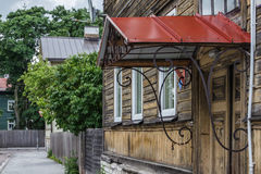 Historic Door with Metal Awning. Awninged entrance of an historical house in downtown of Tallinn, Estonia Stock Image