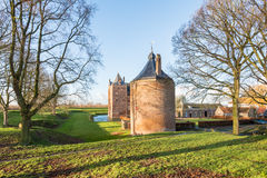 Historic Dutch castle in low sunlight Royalty Free Stock Photos