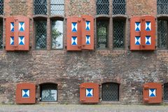 Historic Dutch house with wooden shutters Royalty Free Stock Photos