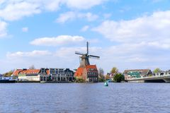 Historic Dutch Windmill in Zaanse Schans on the Zaan River in the Netherlands stock image