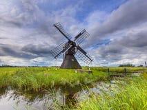 Historic Dutch Wooden Windmill Stock Photo