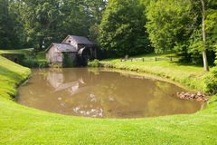 Historic Edwin B. Mabry Grist Mill (Mabry Mill) in rural Virginia on Blue Ridge Parkway and reflection on pond in summer Stock Images